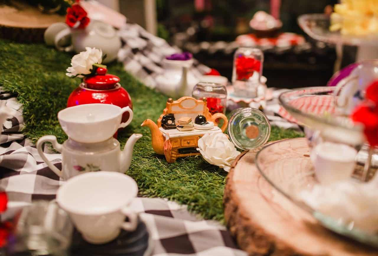 Twisted alice in wonderland themed set design available to book for a variety of themed events