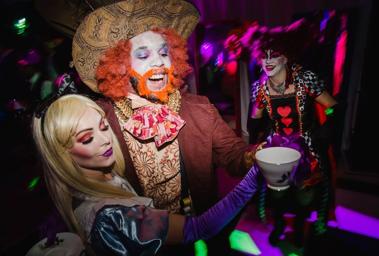 Twisted alice in wonderland inspired entertainment available from event management company