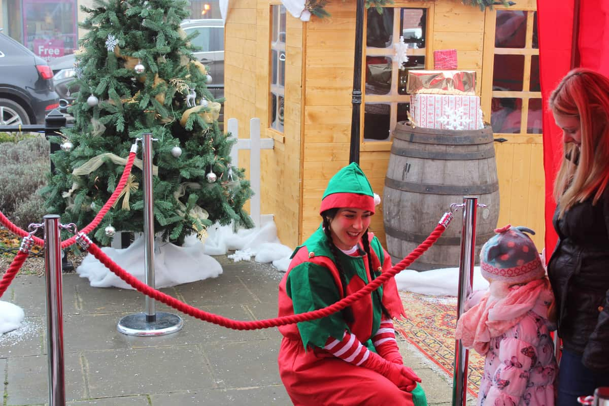 This Christmas Walkabout Entertainer interacting with guests at the event