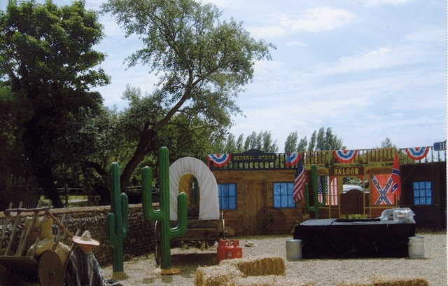 Wild West Frontier Town created with a traditional Saloon, Cacti and other bespoke props used to for a wild west themed family fun day for Amazon.