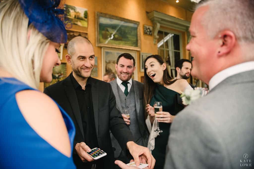 Magician performing card tricks at a Wedding in the UK.