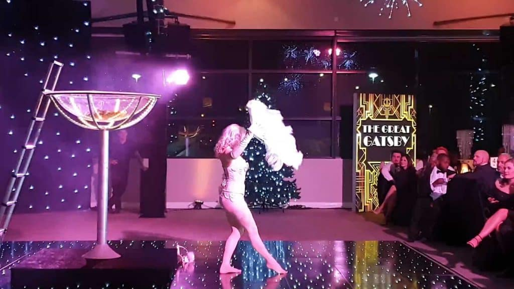 Burlesque performer dancing in giant champagne glass as a part of entertainment for a Great Gatsby event hire