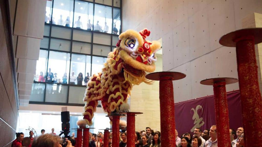 Jumping lion dancers as part of entertainment package provided for Chinese New Year event.