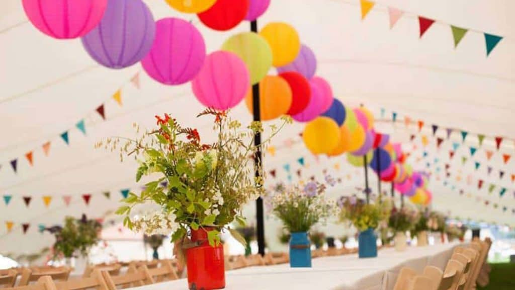 Multi-coloured Easter Bunting Decorations in a large white marquee for an outdoor Easter event.