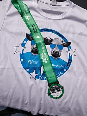 MK Half Marathon 2018 Finishing medal and White MK Marathon Weekend T-Shirt.