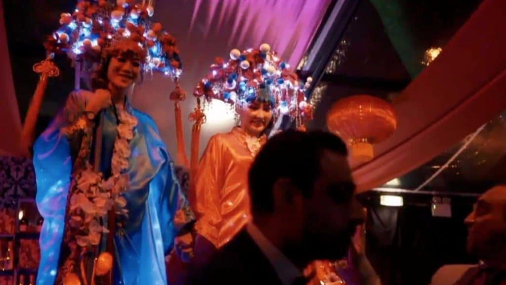 Oriental stilt walkers in full costume, meeting and greeting guests as part of Chinese New Year event