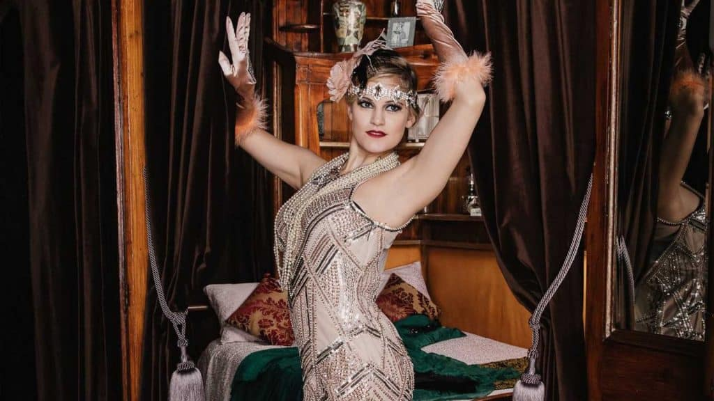 Performer in 1920's flapper girl inspired costume. Great for Peaky Blinders and Great Gatsby events.