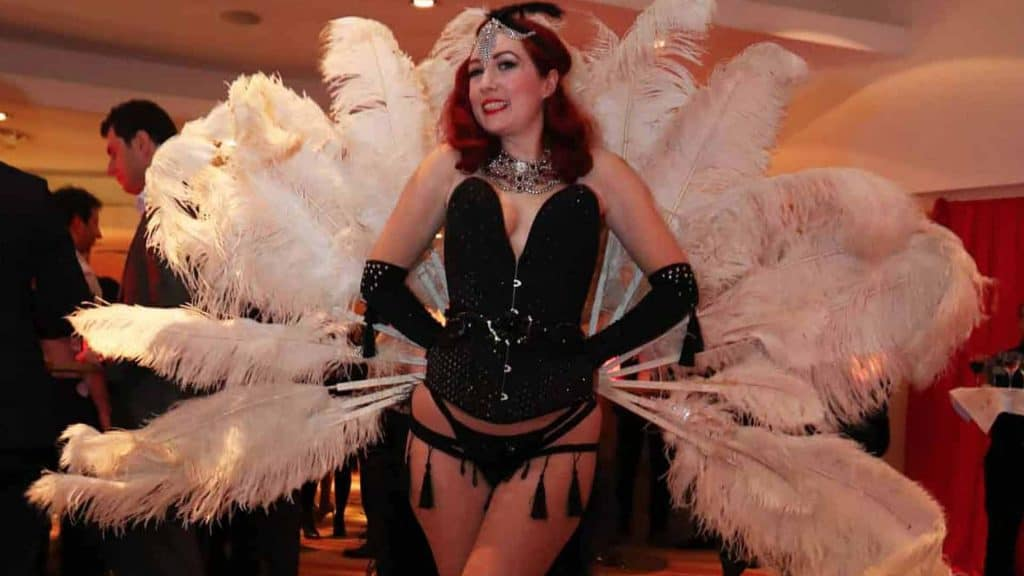 Burlesque performer available to hire as part of love themed event entertainment package. Available to hire UK