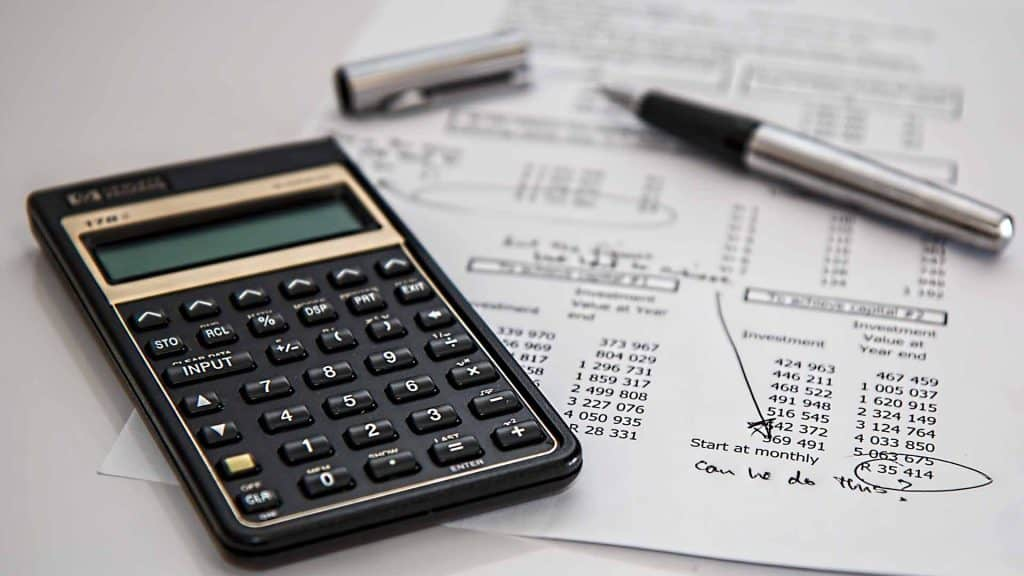 Black Calculator and White Paper with a mix of figures: work out your event budget.