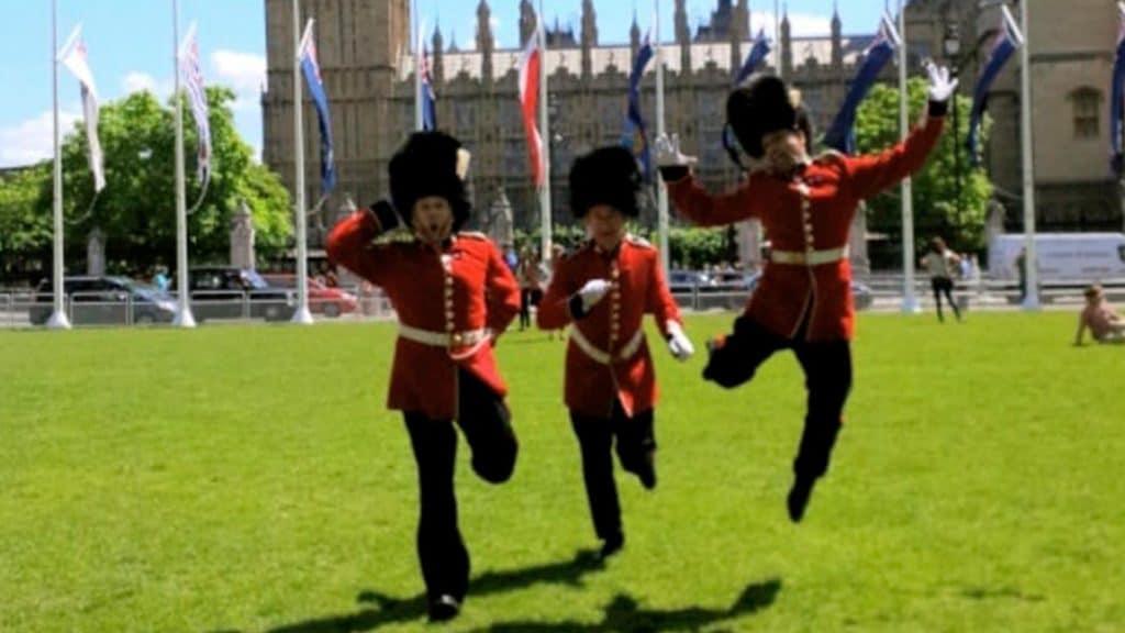 Comedy Palace Guards outside Buckingham Palace.