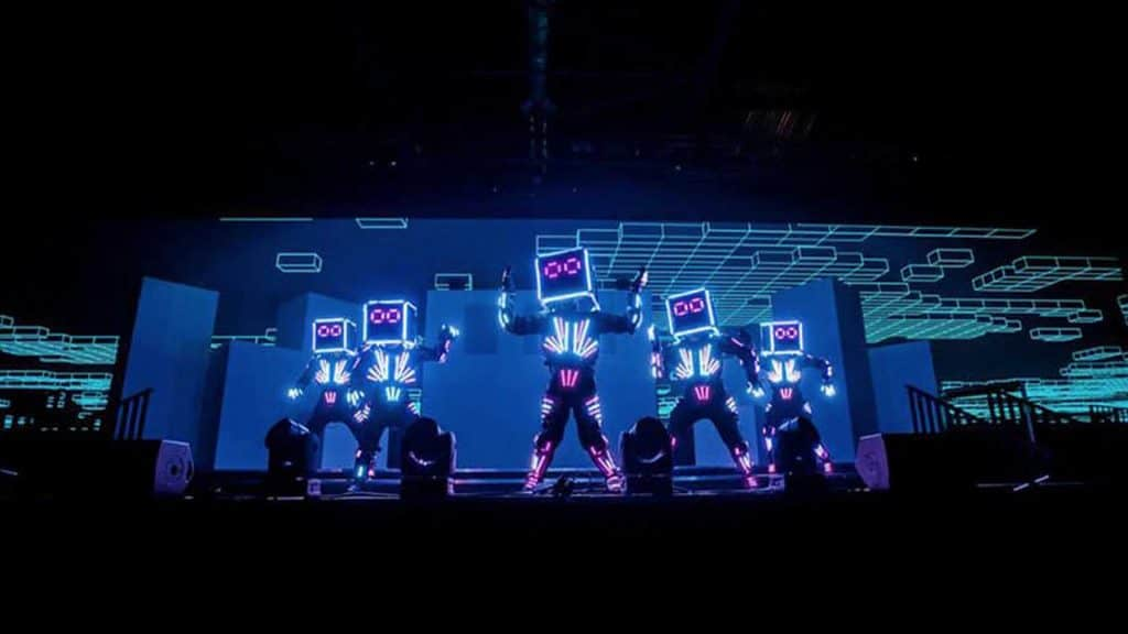 Future technology robot show performing on stage in front of crowd for Sci-Fi themed event