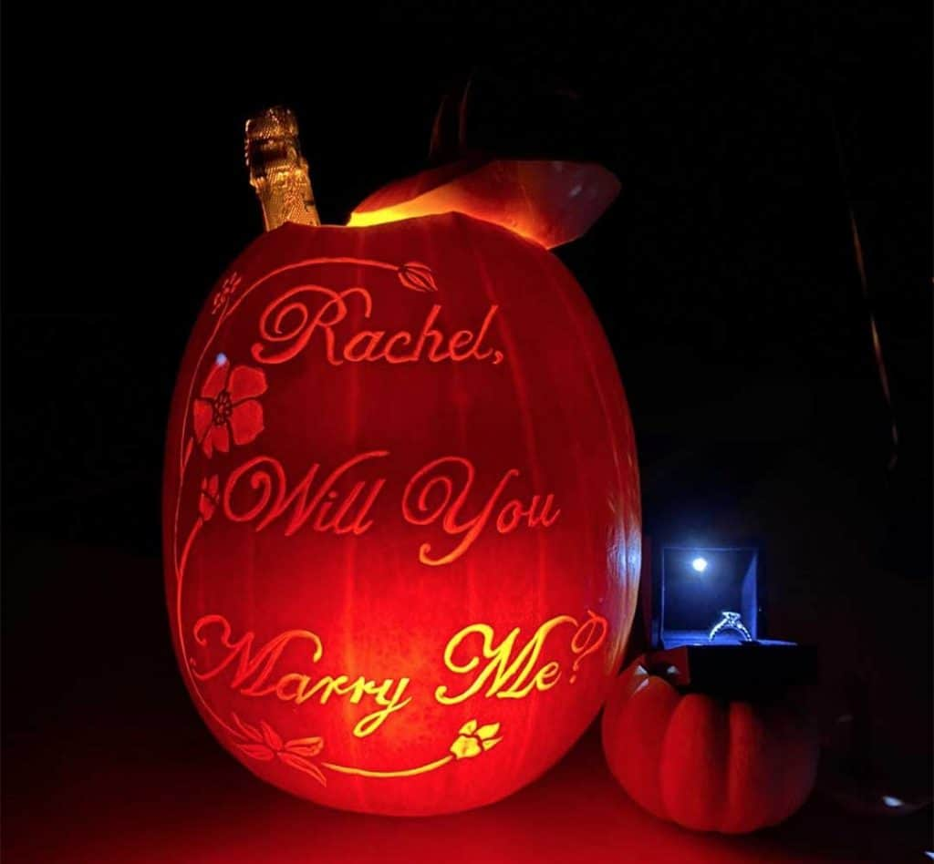 """Rachel, will you marry me?"" carved into a pumpkin by our carving artist."