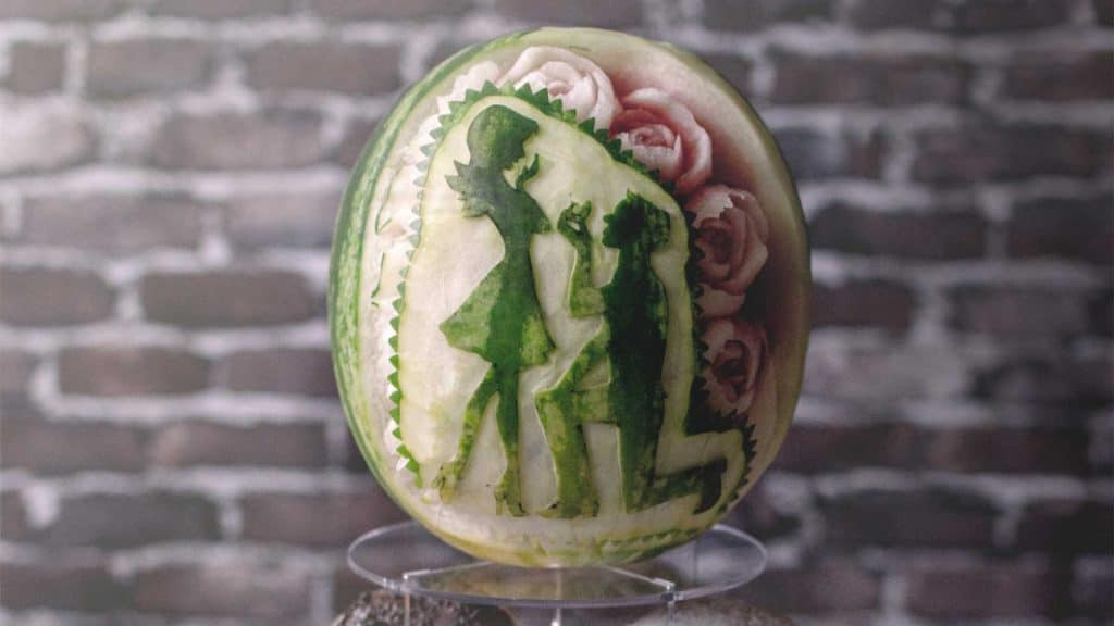 Valentine's Wedding Proposal carved into a watermelon.