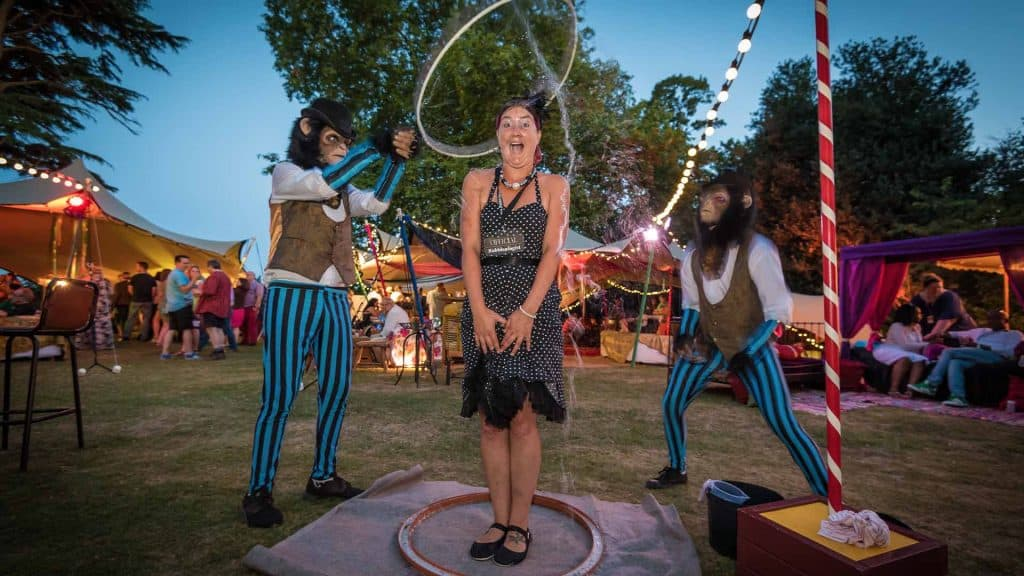 2 Monkeys trapping a lady in a bubble at festival themed production