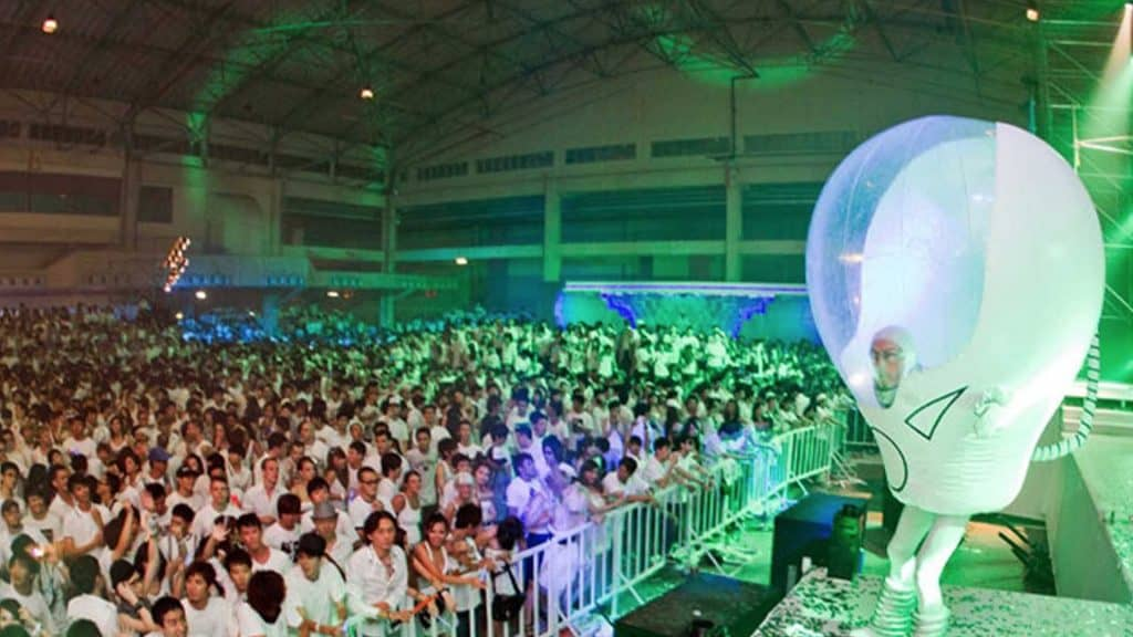 Space bubble performer on stage, entertaining crowd at Sci-Fi event