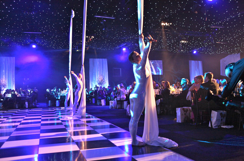 Ribbon Dancers performing on a dance floor at a Gala Dinner and Awards Ceremony event in London.