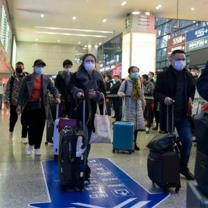 Travellers going through airports wearing face masks to try and prevent transmission of Covid-19