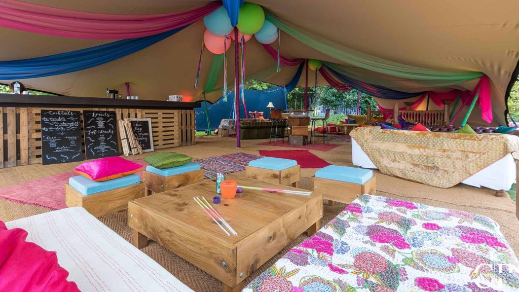 Colourful marquee decorated with festival themed decorations as part of Creative Event Theme at a corporate festival event