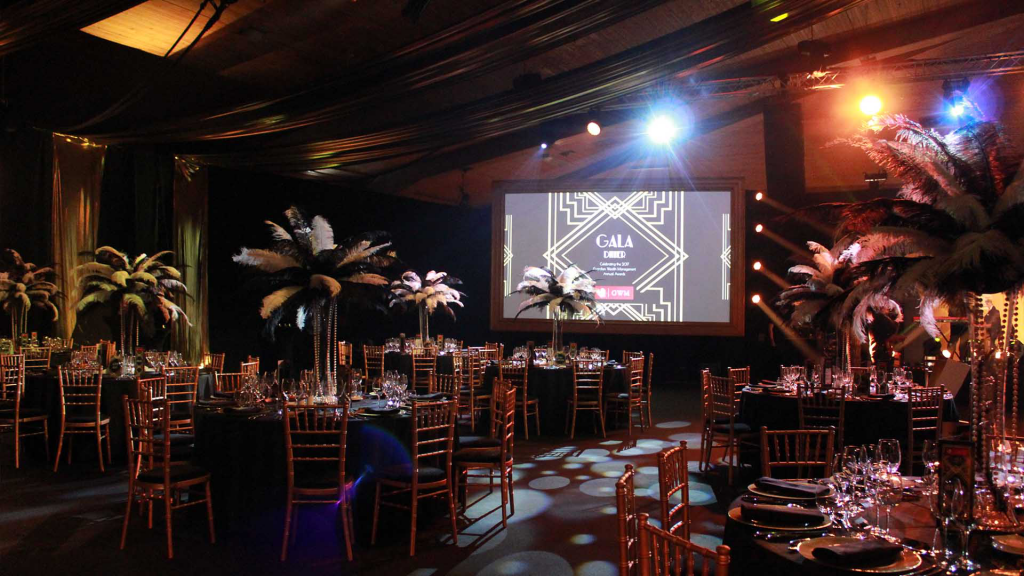 Our Client chose a roaring 20s theme as their Creative event theme at their corporate Gala Dinner. We used 1920s props and colour theming to transform their venue.