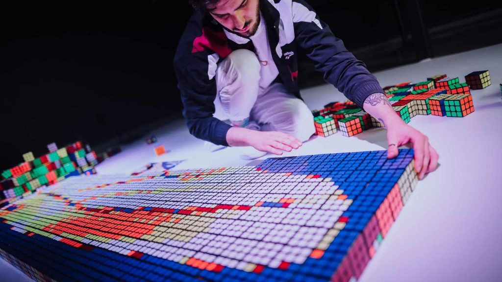 Rubiks Cube Artist, famous for his creations on Instagram @svenb. Now available to book for events around the World. We have a wide range of Artistic performers for hire in the UK.
