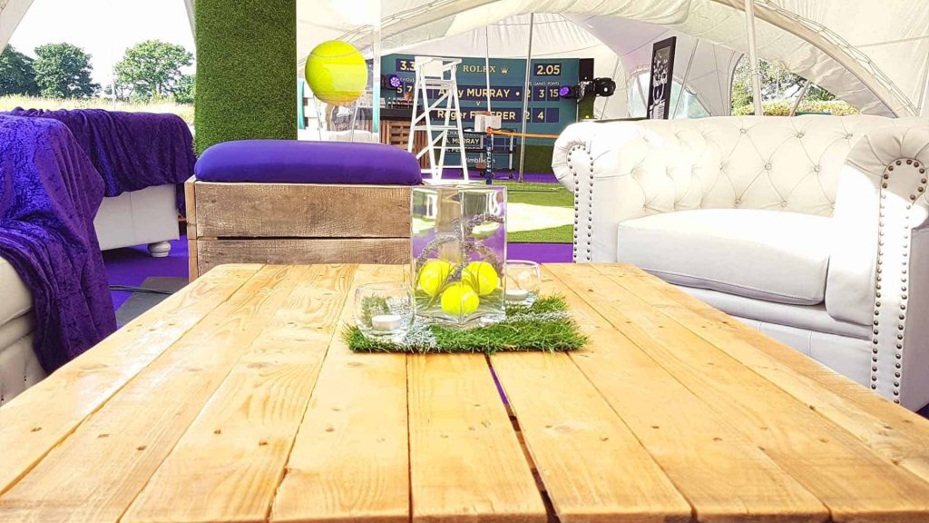 Marquee decorated with Wimbledon themed props for a tennis loving client's birthday. Using our creative Event Theming we came up with a concept of client loved