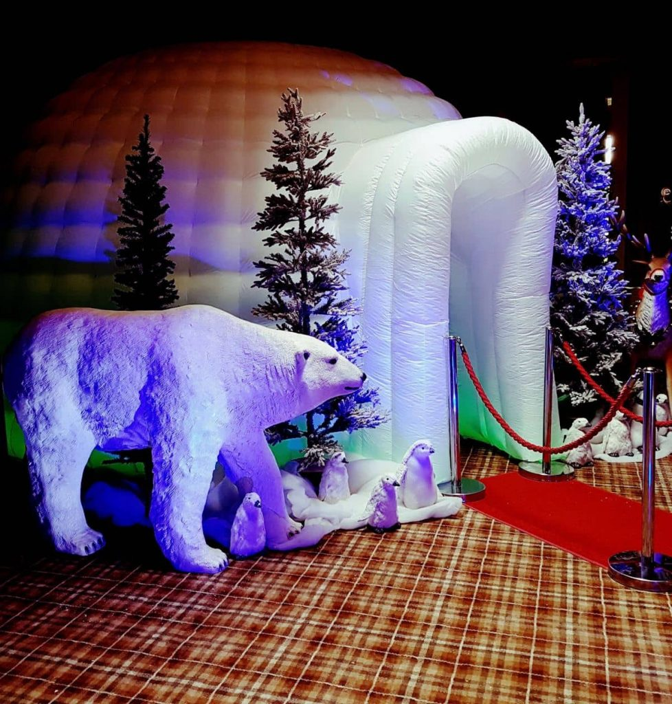 Arctic Photo Booth with polar bear prop, Christmas trees and more available to hire for Christmas Events in the UK.