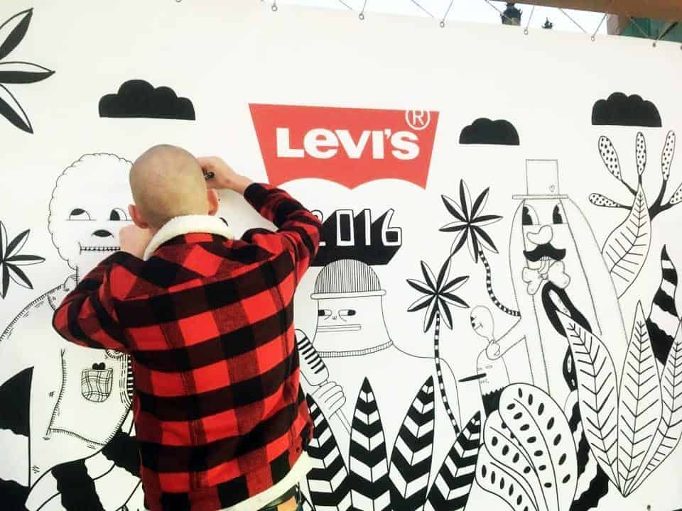 Brand Reveal Entertainment Hire available in London, across the UK and Worldwide. Here you can see one of our Branded Entertainment Options created a branded Levi Jeans mural on a white wall for a marketing event.