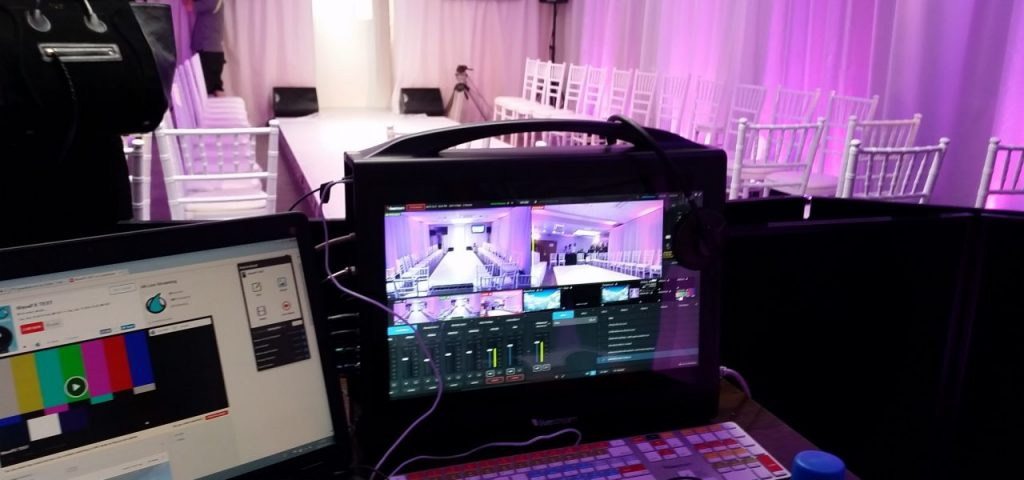 Our event management company tech team with live streaming equipment to capture a company fashion show. Part of our virtual conference management services where we can provide virtual streaming services for your company