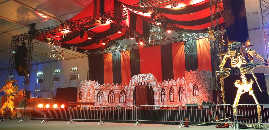 Castle stage set design and large-scale props used to decorate event space for Horror Festival in Saudi Arabia
