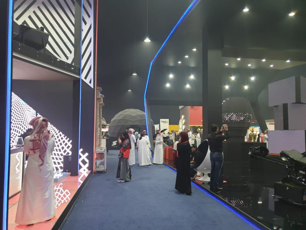 Women wearing different clothing options at Saudi Arabia business event