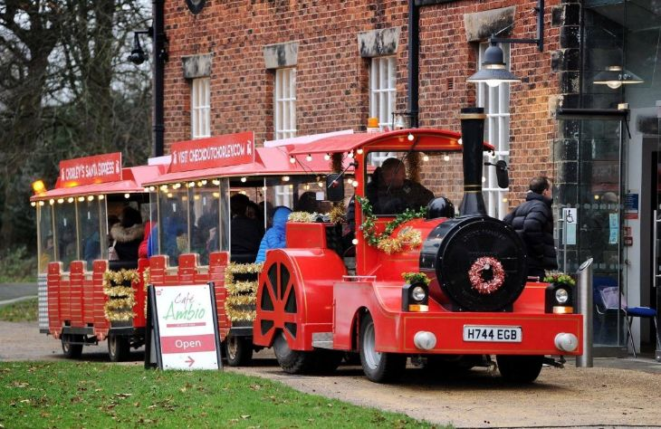 Christmas Land Trains for hire in red and gold adorned with garlands