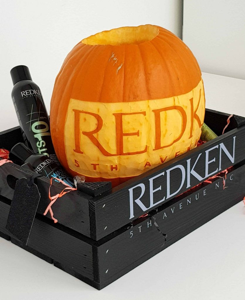 REDKEN branded pumpkin created by our Halloween Pumpkin Carving Artist who can provide online tutorials for guests on Zoom calls this Halloween.