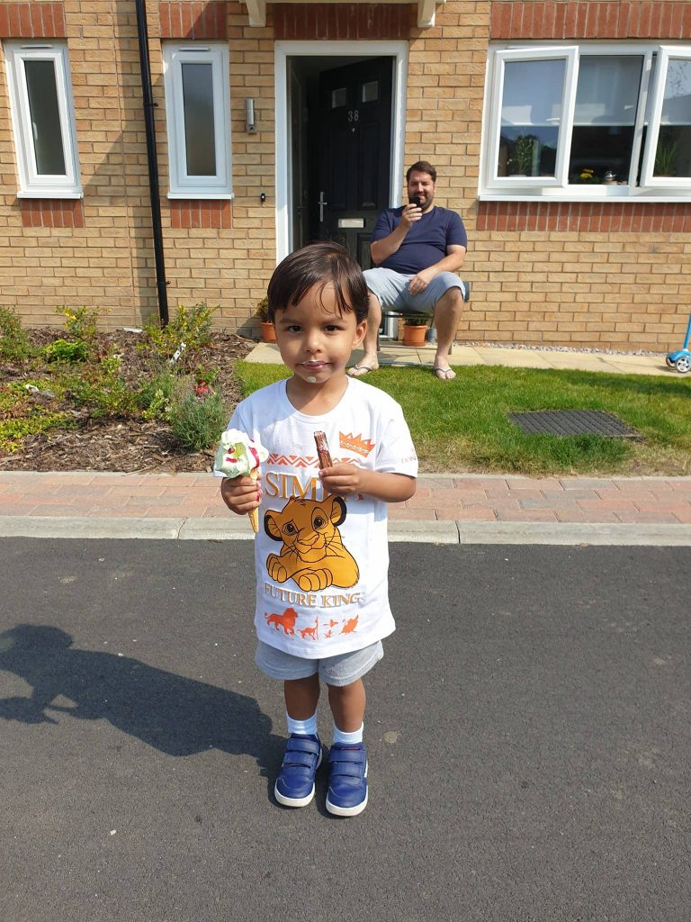 Child enjoying ice cream at our Socially Distanced outdoor event we created and managed for Simple Life.