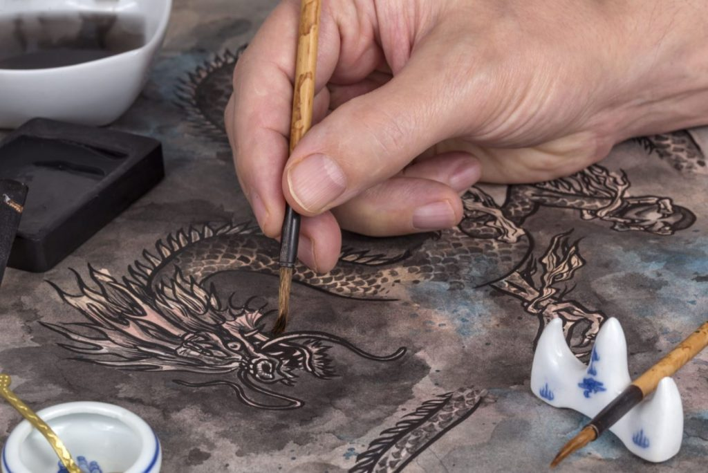 Client creating a Dragon Painting as part of our Virtual Chinese dragon painting workshop. We have a wide range of Online, Virtual Chinese New Year Entertainment available to hire for Chinese New Year 2021.