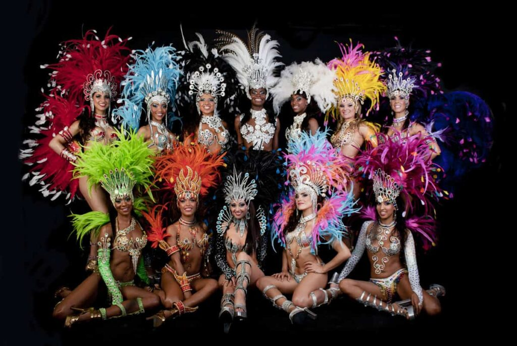 Group of brightly coloured female Brazilian carnival inspired festival dancers for hire