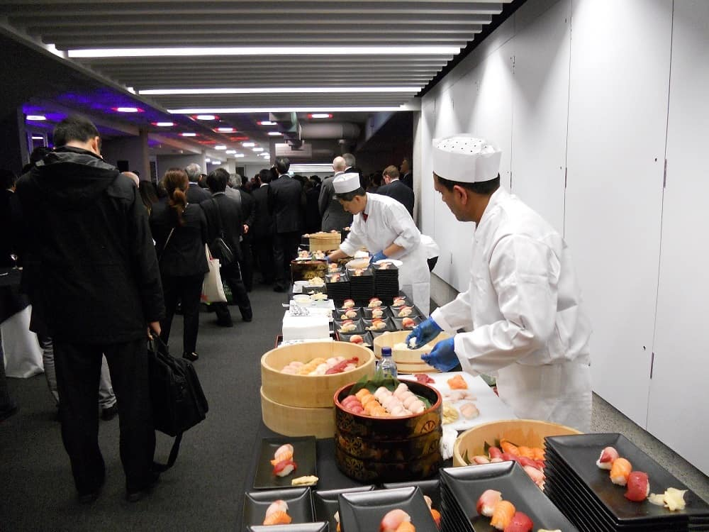 Caterers setting up for delegates meal at conference event.