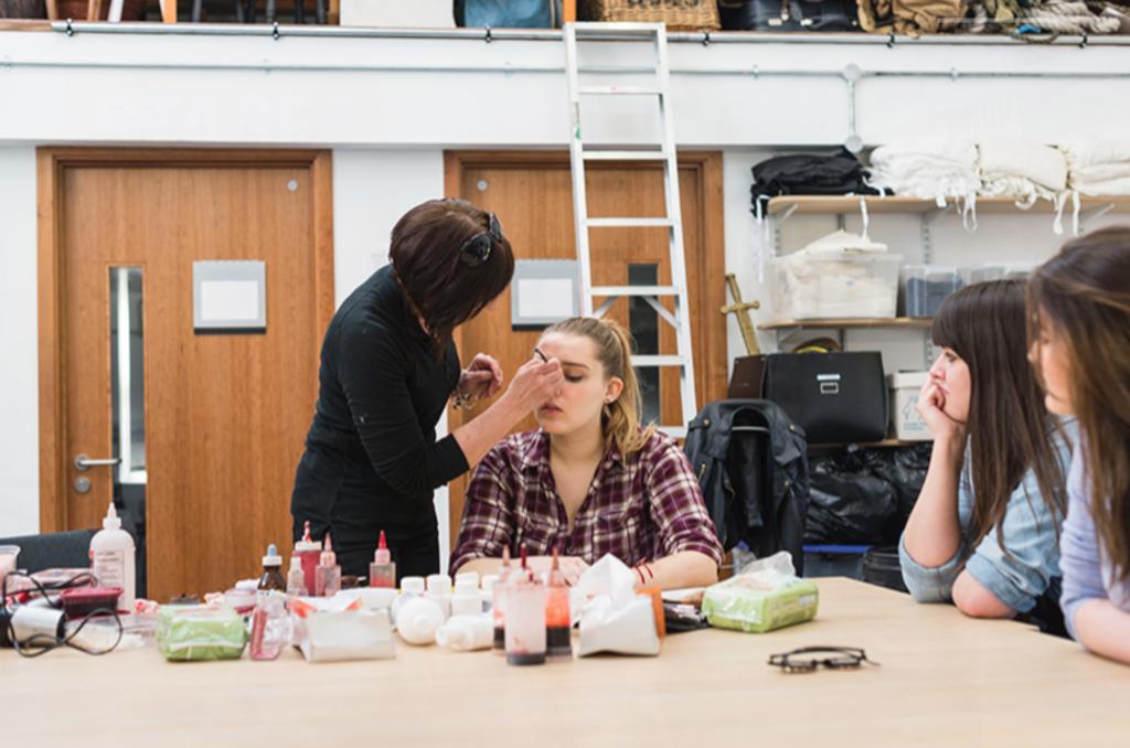 SFX Makeup Workshop instructor giving demonstration to pupils.